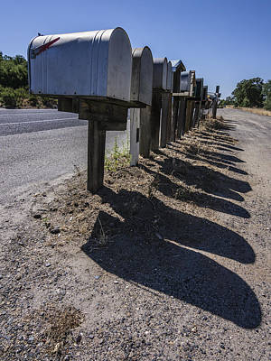 Row Of Mailboxes And Shadows Print by David Litschel