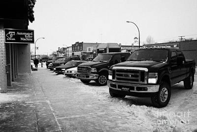 row of trucks and cars parked on the main street Biggar Saskatchewan Canada Art Print by Joe Fox