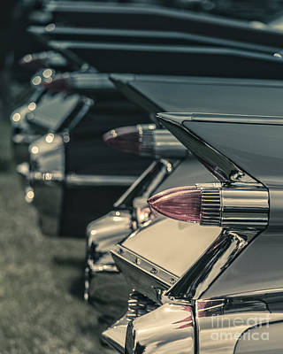 Row Of Vintage Car Fins Print by Edward Fielding