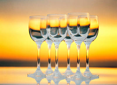 Radiant Image Photograph - Row Of Wineglasses Against Golden by Panoramic Images