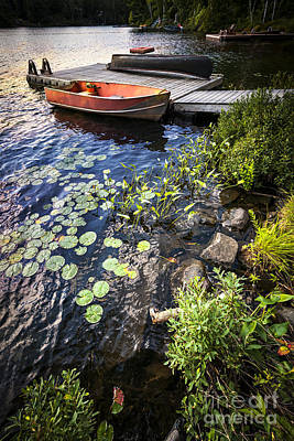 Rowboat At Lake Shore Art Print
