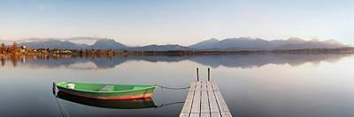 Rowboat Moored At A Jetty On Lake Art Print