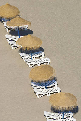 Rows Of Parasols On The Beach Of Art Print by Ian Cumming