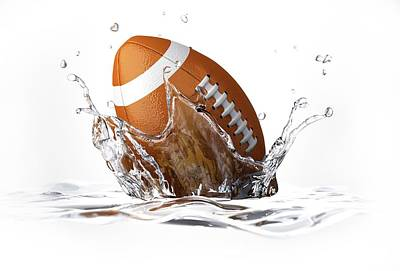 Rugby Photograph - Rugby Ball Splashing Into Water by Leonello Calvetti