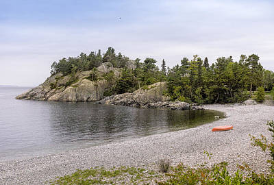 Canoe Photograph - Rugged Cliffs And Pebble Beach by Panoramic Images