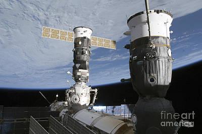 Russian Soyuz And Progress Spacecrafts Print by Stocktrek Images