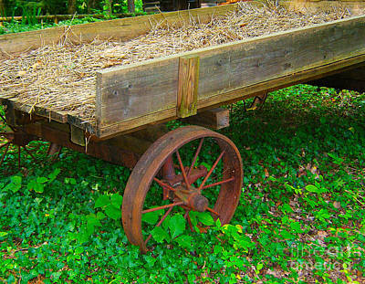 Rusted Wagon Wheel Art Print by Val Miller