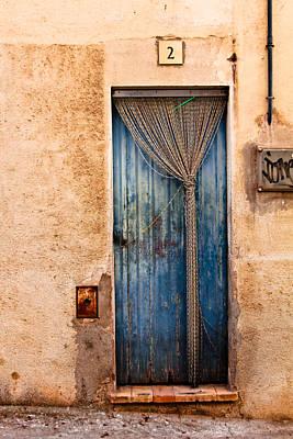 Door Photograph - Rustic Door In Catalonia Spain by Calvin Hanson