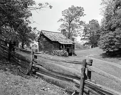 Old Log Cabin Photograph - Rustic Log Cabin From 1880s Behind Post by Vintage Images