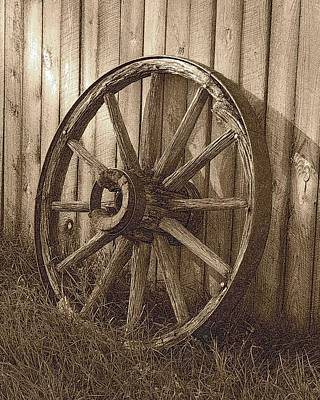 Photograph - Rustic Wagon Wheel by Dakota Light Photography By Dakota