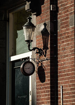 Photograph - Rustic Wall Clock Against Facade by Marinus Ortelee