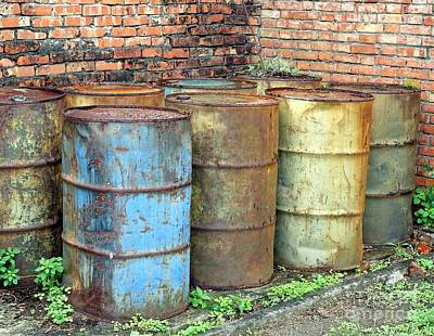 Rusting Oil Barrels Print by Yali Shi