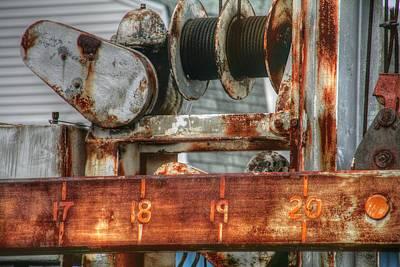 Ocean Photograph - Rusty Boat Lift by Heather Allen