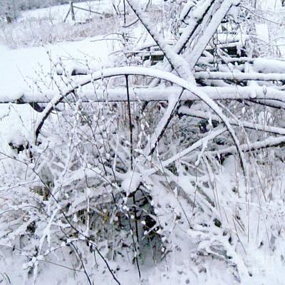 Photograph - Rusty Horse Drawn Farm Equipment In Snow by Conni Schaftenaar