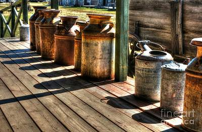 Wagon Wheels Photograph - Rusty Western Cans 1 by Mel Steinhauer
