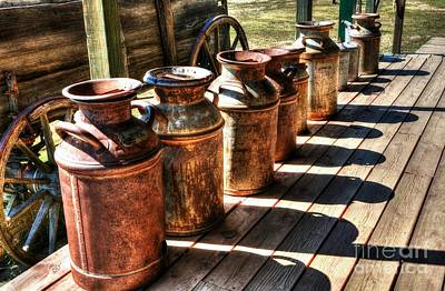 Wagon Wheels Photograph - Rusty Western Cans 2 by Mel Steinhauer
