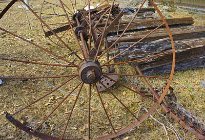 Photograph - Rusty Wheel by Laurie Perry