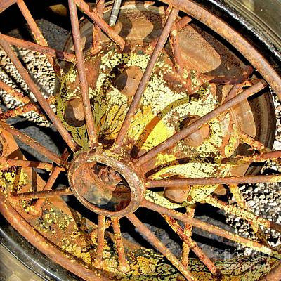 Photograph - Rusty Wheel by Marilyn Smith