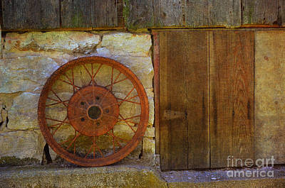 Photograph - Rusty Wheel by Luther Fine Art