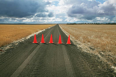 Photograph - Safety Cones Lined Up Across A Rural by Benjamin Rondel / Design Pics
