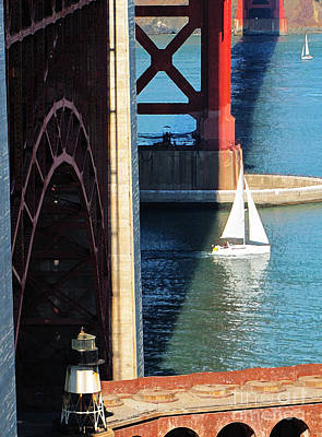 Sail Boat Passes Beneath The Golden Gate Bridge Art Print