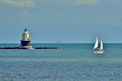 Photograph - Sailboat At Harbor Of Refuge Lighthouse by Kim Bemis