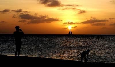 Photograph - Sailboat Hits Sunset At Aruba Beach by Ron Bartels