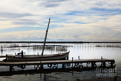 Photograph - Sailing Boat Being Prepared On The Jetty On Lake Albufera Spain by Peter Noyce