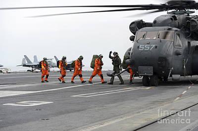 Sailors Board An Mh-53e Sea Dragon Art Print by Stocktrek Images