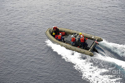 Inflatable Photograph - Sailors In A Rigid-hull Inflatable Boat by Stocktrek Images