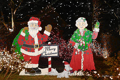 Photograph - Santa And Mrs Claus by EricaMaxine  Price