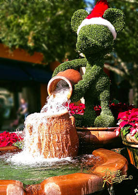 Photograph - Santa Mickey Topiary Fountain by Doug Kreuger