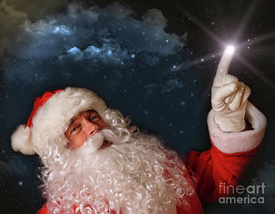 Santa Pointing With Magical Light To The Sky Art Print by Sandra Cunningham