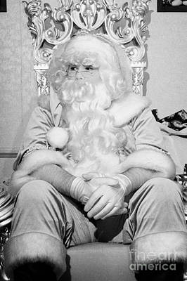 Santa Sitting On His Throne Looking Away From Camera In Grotto Set Up  Art Print