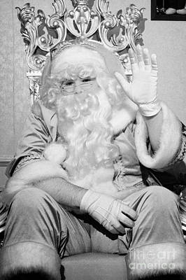 Santa Sitting On His Throne Waving To Camera In Grotto Set Up Art Print