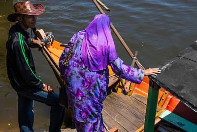 Working Cowboy Photograph - Sarawak River Boatman And Embarking Passenger by Paul Donohoe