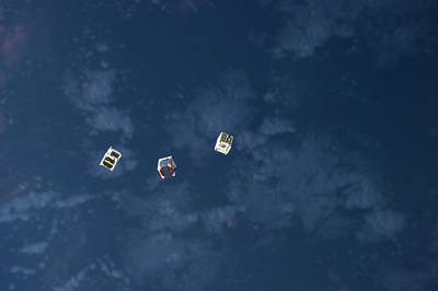 Trio Photograph - Satellites From The Iss by Nasa