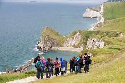 Sea Arch Photograph - School Field Trip At Durdle Door by Ashley Cooper