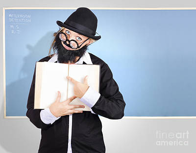 School Teacher In Classroom Pointing To Empty Book Art Print by Jorgo Photography - Wall Art Gallery