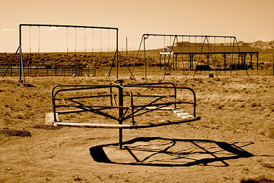 Framed Swing Set Photograph - School Yard Mary-go-round Sepia Photograph by Jerry Cowart