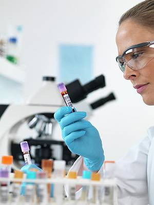 Technician Photograph - Scientist With Blood Sample by Tek Image