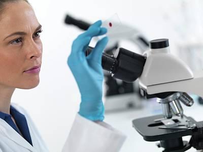 Scientist With Microscope Slide Art Print by Tek Image