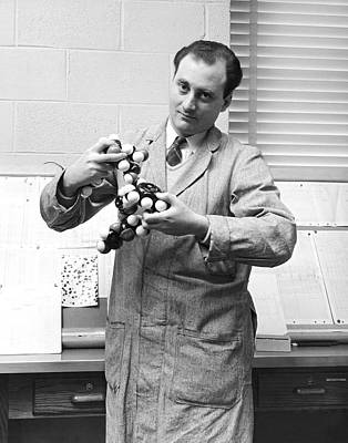 Scientist With Molecule Model Art Print by Underwood Archives