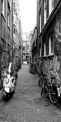 Scooters And Bicycles Parked Print by Panoramic Images