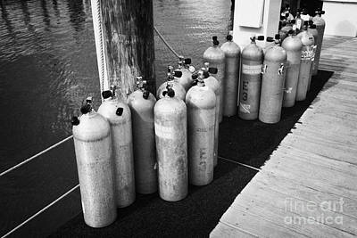 Underwater Breathing Photograph - Scuba Air Tanks Lined Up On Jetty To Be Filled In Harbour Key West Florida Usa by Joe Fox