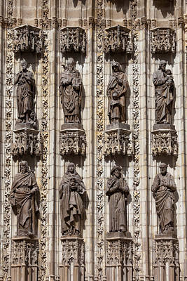 Relief Carving Photograph - Sculptures Of Saints On Seville Cathedral Facade by Artur Bogacki
