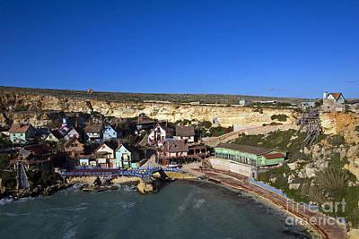Clapboard Houses Photograph - Seaside Village, Malta by Tim Holt
