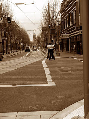 Police Officer Photograph - Segwaying Down The Street by David Bearden