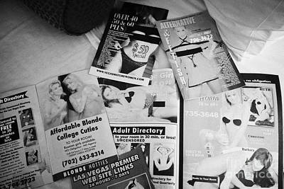 selection of leaflets advertising girls laid out on a hotel bed in Las Vegas Nevada USA Art Print by Joe Fox