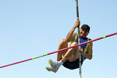 Indecision Photograph - Senior Athlete Might Not Clear Pole Vault by Alex Rotas